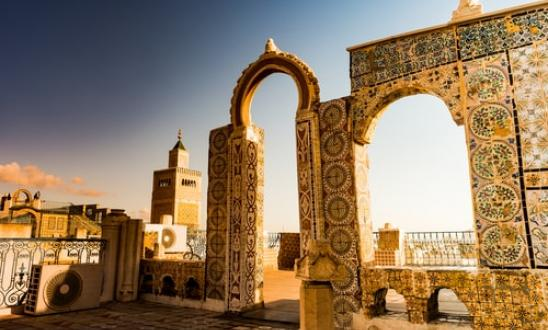 detail_of_traditional_arabic_architecture_in_cityscape_at_dawn_with_dramatic_sunlight.